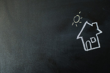 image of a house with chalk on a blackboard
