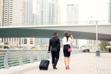 Business people walking at Dubai Marina.