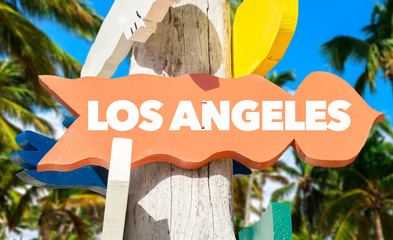 Los Angeles signpost with palm trees