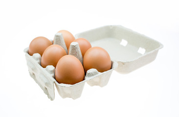Eggs in paper tray isolated on white