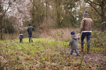 Family On Winter Walk In Countryside Together