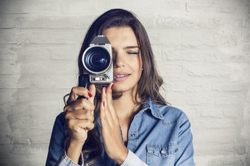 Portrait of a beautiful girl using a video camera