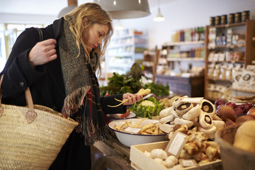 Woman shopping for vegetables indoors