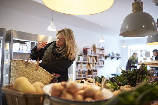 Woman Shopping For Organic Produce In Delicatessen