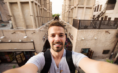 Tourist making selfie at old arabian town.