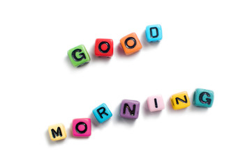 Good morning spelled out in colorful cube beads