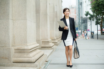 Young Businesswoman walking on street