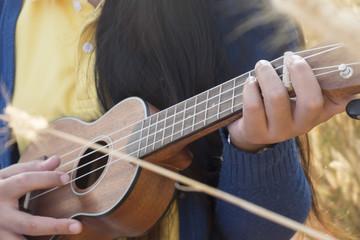 Beautiful asian women with ukulele