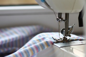 the sewing machine and striped fabric for a sheet