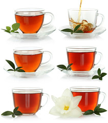 Cups of tea set with green leaves on a white background