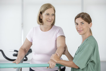 Physiotherapist helping senior woman