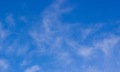 Fantastic soft white clouds against blue sky