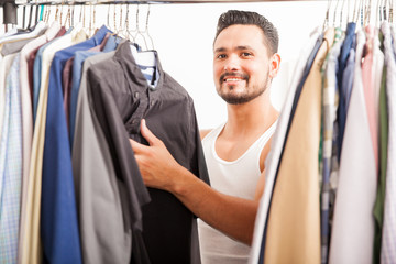 Hispanic young man getting dressed