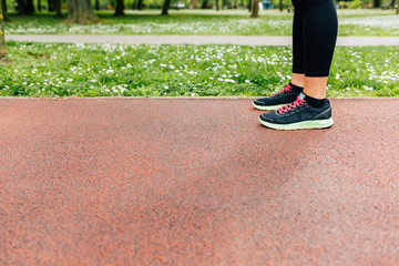 Runners legs on jogging track