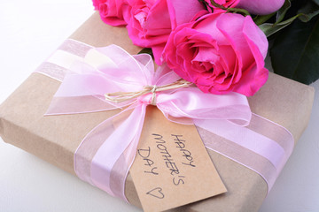 Brown Paper gift and pink roses.