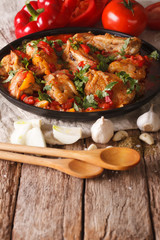 Georgian cuisine: Chakhokhbili chicken stew with vegetables. vertical