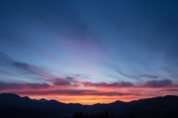 Colorful beautiful sunset over the mountain hills