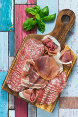 beautiful collection of sausages,ham,parma,salami on rusty wooden background.