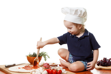 Little boy cook pizza. Closeup isolated on white
