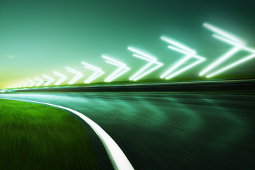 Wall Mural - Motion blurred racetrack,night scene cold mood. with arrow light Effects..