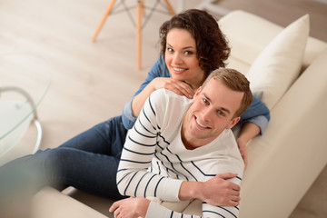 Delighted couple sitting on the couch