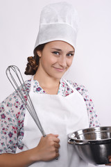 female chef with kitchen tools
