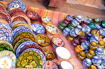 Traditional arabic handcrafted, colorful decorated plates shot at the market