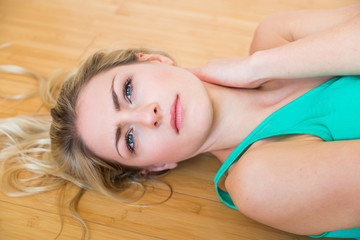 Cute serious woman laying down on floor