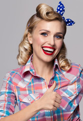 smiling woman, showing thumb up gesture, dressed in pin-up style