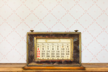 Vintage desktop calendar on a wooden table