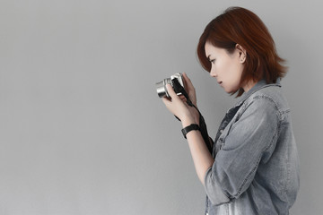 Photographer girl shooting images with copy space area, japan picture style