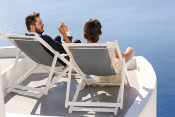bride and groom relaxing and enjoying sea view
