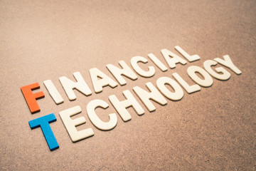 Financial Technology wording on brown background