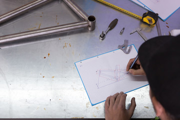 Man doing drawing of bicycle