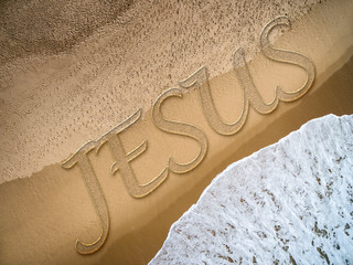 Jesus written on the beach