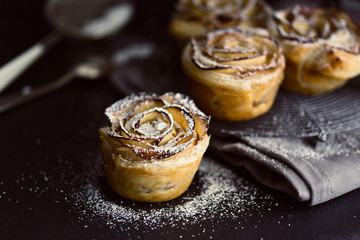mini apple roses puff pastry with icing sugar.
