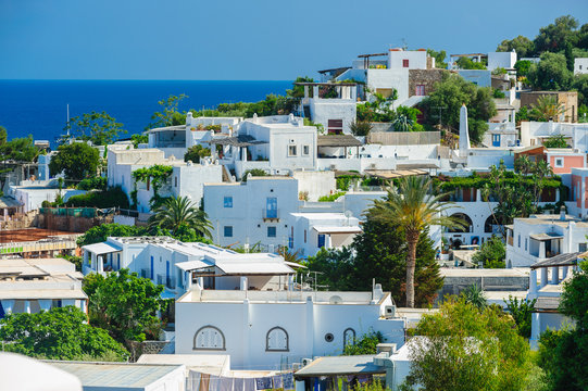 A view of Panarea island with typical white houses, Italy.