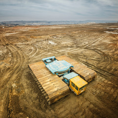 Aerial photo of coal mine transportation vehicle photographed with wide angle lens.