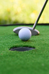 Golf field hole with cross and ball suggesting achievement of goals concept