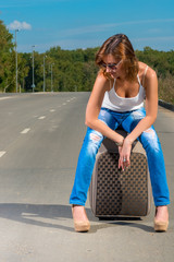 girl waiting for of associated car on the road