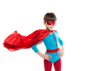 Boy superhero in a red cloak in the wind and mask isolated on white background.