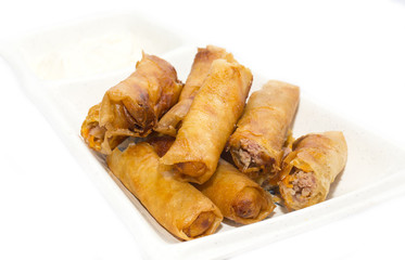 fried rolls with garlic sauce on a white background