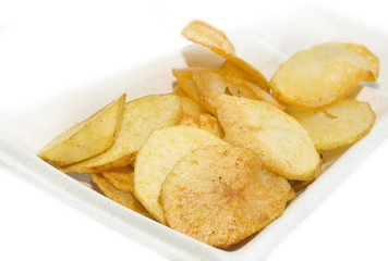 fried potatoes on a white plate in a restaurant