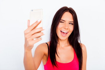 Pretty young woman winking and making selfie