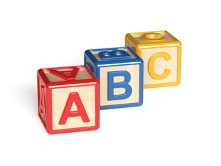 Colorful wooden alphabet blocks isolated on white background