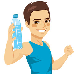 Healthy young man showing bottle of mineral water smiling happy