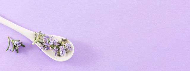 Rosemary flowers in a  spoon