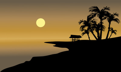 Silhouette of beach and hut