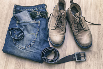 Jeans, belt ,shoes and wallet on wood floor