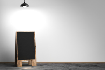blank blackboard with lamp